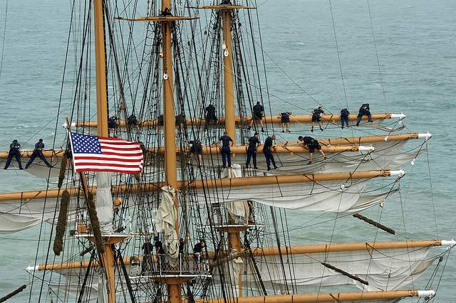 CORPUS CHRISTI, Texas - The crew aboard the Coast Guard Cutter Eagle work to take in the sails as the ship heads to Corpus Christi, Texas, July 2, 2010. Crewmen work in the rigging nearly 100 feet above the water. U.S. Coast Guard photo by Petty Officer 2nd Class Patrick Kelley.