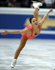 FILE - In this March 27, 2004, file photo, Michelle Kwan from the United States, performs her free skating program at the World Figure Skating Championships in Dortmund, Germany. Kwan, the most decorated figure skater in American history, has been elected to the U.S. Figure Skating Hall of Fame. She will be inducted into the hall during the national championships in San Jose, Calif., at the end of January. (AP Photo/Martin Meissner, File)